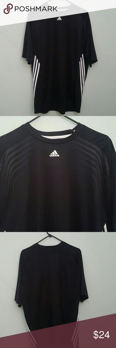Short sleeve shirt Adidas short sleeve shirt. White stripes on sides. Black on black stripes on upper Chest. Chest 46 inches. Length 28 inches. Adidas Shirts Tees - Short Sleeve