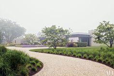 A Bridgehampton, New York, house nestles into serene gardens by Gunn Landscape Architecture.