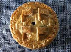 A pie is a great crowd pleaser and this won 'Best chicken pie' in the  British Pie Awards 2015  400g puff pastry 75ml oil 25g butter 2 x 150g chicken fillets, boneless and skinless 50g finely chopped shallots 1 clove garlic, crushed 50g sliced white button mushrooms 25g smoked bacon, finely chopped 150ml white wine 25g plain flour for dusting 300ml fresh double cream Chopped fresh parsley 100g thinly sliced haggis (optional) 1 medium egg 7-inch foil dish Salt and white pepper   1 Preheat…