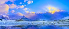 Evanescent light over Eastern Icelandic Fjords (Panorama).  Photographed by Julia Apostolova.