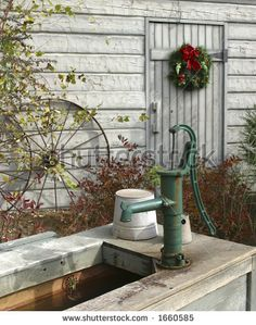 Google Image Result for http://image.shutterstock.com/display_pic_with_logo/70320/70320,1155159859,6/stock-photo-barnyard-with-christmas-wreath-on-white-barn-wagon-wheel-and-water-pump-1660585.jpg