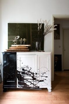 black and white cabinet with splatter