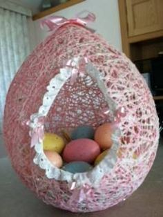 This was made 24 years ago by my mother. It's made of yarn and a sugar/water mix. It was my daughter's easter basket the first year she was born. I still have it =)