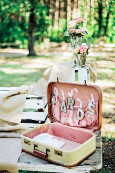 Vintage suitcase with pink lining to collect wedding cards {Andie Freeman Photography}