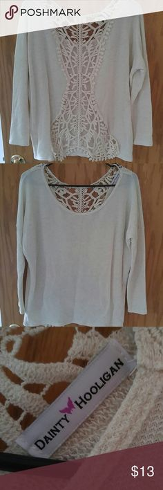 Lace back dainty hooligan top Long sleeve Cream colored top with beautiful open lace back. Fits loosely dainty hooligan  Tops Tees - Long Sleeve