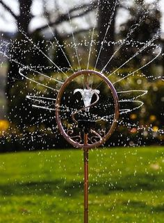 Some sprinklers are an eyesore but not the Solar Flower Sprinkler Sculpture, which, doubling as yard decor, waters the lawn when attached to a hose. At dusk, a decorative flower glows in the middle of this copper-finish sculpture.