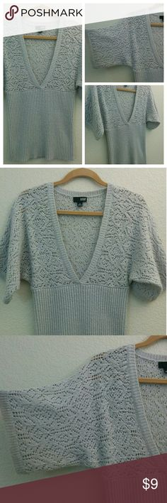 """Sweater Deep """"V"""" This cute sweater has a deep """"V"""", is neutral in color with a little sparkle and fits a Med-Large It has a little pilling and edge """"fuzz""""  It's very flattering with a V neck T shirt underneath. Sweaters V-Necks"""