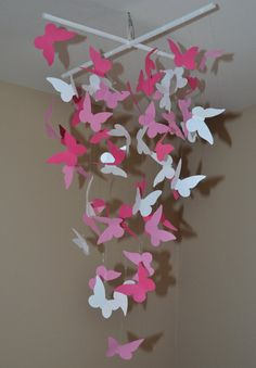 Pink Butterfly hanging Decor CHEAP and CUTE for girl's room on Etsy check it out  Hmm... maybe make something like this for a gift. Kind of like a baby mobile??.