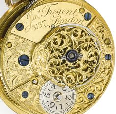 James Tregent London AN IMPRESSIVE GOLD, ENAMEL, DIAMOND AND PEARL-SET VERGE WATCH WITH MATCHING CHATELAINE CIRCA 1790, NO. 3137 • Movement: gilded full plate movement, verge escapement, flat three-arm balance, decoratively pierced balance cock engraved with foliage, fusee and chain, cylindrical pillars, signed Jas. Tregent, 3137 • Dial: white enamel, radial Arabic numerals, outer Arabic minute ring, winding aperture at 4 o'clock, gold beetle & poker hands • Case: gold, the back with blue…