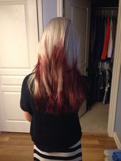 Platinum blonde hair with red tips on all the different layers. Love it!!
