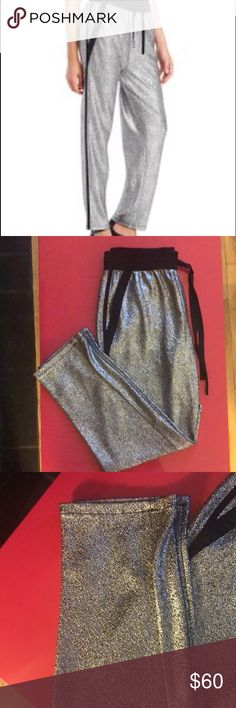 Kenneth Cole metallic Drawstring pants. Never worn. Bought a couple of years ago and been sitting in my closet. I just don't have the body for it. Beautiful and sexy tho. Kenneth Cole Pants Trousers
