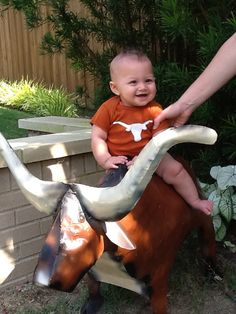 This little guy knows how to Hook 'em! #Longhorns #UT #cutebaby
