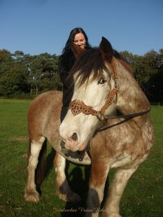 Me and my Clydesdale Brittje! <3 With my own handmade leather halter I specially made for her and my little pony Zjup!