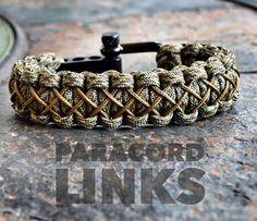 La pulsera de Links de diamante con un grillo negro o acero