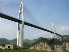 Malinghe River Bridge is a 241 metre high cable-stayed bridge near Xingyi, in the Guizhou province of China. As of it is among the 25 highest bridges in Cable Stayed Bridge, Provinces Of China, High Bridge, Tensile Structures, Kunming, Bridge Design, Beautiful World, Bridges, River