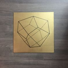 This is a geometric shape painted with oil paint on a metallic gold background on a 12inx12in canvas. This canvas is made to fit perfectly in the Ikea