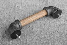 Each drawer pull is hand crafted from black iron pipe fittings and oak wood. The…