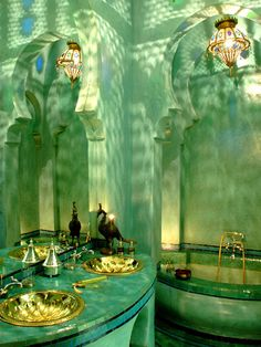 Beautiful lighting in this Moroccan bathroom; looks like a scene from the little mermaid or something - green bathroom with gold sinks Moroccan Bathroom, Bohemian Bathroom, Moroccan Decor, Moroccan Style, Bathroom Green, Moroccan Interiors, Gold Bathroom, Peacock Bathroom, Indian Bathroom