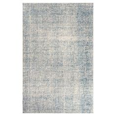 Showcasing a variegated design in blue and ivory, this looped wool rug effortlessly anchors your dining table or living room seating group. ...