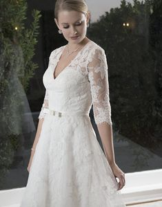 Short V neckline with illusion lace sleeves. Satin band with bow. Zipper back with buttons.Fabric(s):Lace/New Tulle/Lush satin/Soft NettingColor Available:White, IvorySize:2 to 28; P3 to P17