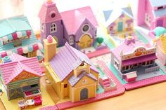 Omg I have that purple one at the back! It's a church and its tiny people are on their wedding outfits. :)