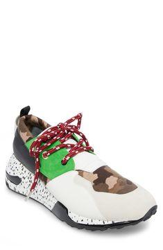 b13847ca3b9 STEVE MADDEN Eskape Perforated High-Top Sneakers.  stevemadden ...