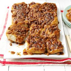 Caramel-Pecan Sticky Buns Recipe -My mother used to make delicious cinnamon rolls when I was a child. Later, she taught my sister and me to… Gooey Cinnamon Rolls Recipe, Pecan Cinnamon Rolls, Pecan Rolls, Pecan Sticky Buns, Sticky Rolls, Holiday Bread, Holiday Baking, Caramel Pecan, Vegan