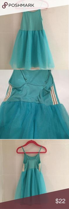 🌸Crewcuts tulle tank dress 💕 Darling dress from J Crew. Cotton jersey and 3 layers of tulle turquoise skirt. Has white and gold detail on side of top. Adjustable straps makes it grow with your child. It kind of fits large. I purchased last year it for my big 3 year old and still fits, but we hardly wore it. Perfect condition. Smoke and pet free household. Crewcuts Dresses