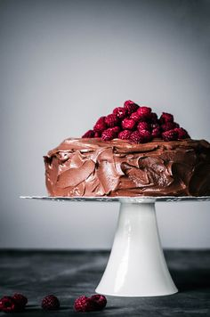 This one-bowl vegan chocolate raspberry cake is topped with a creamy coconut milk ganache for a decadent summer dessert made with healthier ingredients. #vegan #healthyrecipes #onebowl #chocolate #cake #raspberries #summer #baking