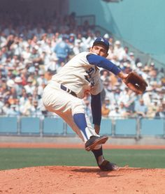 Dodgers hurler Sandy Koufax unleashes a pitch during the 1966 World Series against the Orioles in the 1966 World Series. (Herb Scharfman/SI)