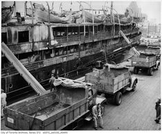 Toronto 1940s The side of the burned out SS Noronic. In the aftermath of the fire, an investigation found the design of the ship was partly to blame for the high death toll. Many people leapt to their death on the dockside, others died from smoke and burns.