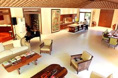 The area in the house which used to be the terrace is now the living room. High ceilings and an open layout give the space a sense of airiness. Sliding glass doors (not seen in photo) give an unobstructed view of the garden outside.   A noticeable design in the house is the thatched anahaw ceiling, a unique element that reinforces the home%u2019s tropical Asian feel.manny villar hauz
