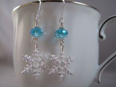 Snowflake Earrings, Blue Crystal, Sterling Silver and Enameled Pewter Snowflakes. $18.00, via Etsy.