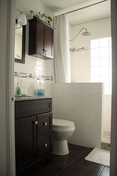 Walk in shower and subway tile.  Dark   cabinets.  Easy way to renovate the standard-sized bathroom. Possibly for the   boys bathroom