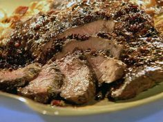 Johnny Garlic's Grilled Peppered Steak with Cabernet Balsamic Sauce recipe from Guy Fieri via Food Network