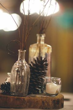 Twigs, jars, candles and pinecones - winter table centre perfection!