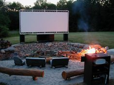 love this. movie screen & fire-pit in the backyard
