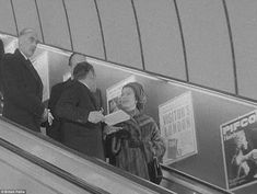 Going underground: The Queen was pictured riding on an escalator in the British Pathe footage filmed at Green Park station in 1969