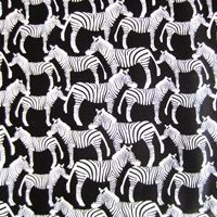 Nothing but graceful zebras at this zoo!  This woven cotton would be great for dresses, pajamas pants, skirts, home decor, or anything for the animal lover!    by Timeless Treasures