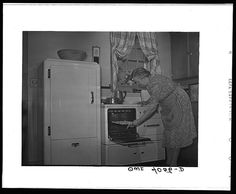June 1942, Knox County, Tennessee (Tennessee Valley Authority (TVA)). Mrs. Wiegel, farm wife, in her electric kitchen. Arthur Rothstein photographer