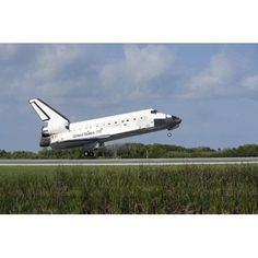 Space shuttle Discovery lands on Runway 33 at the Shuttle Landing Facility at Kennedy Space Center in Florida Canvas Art - Stocktrek Images (34 x 23)