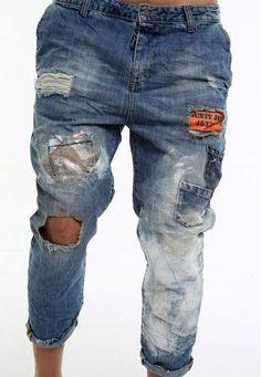los pantalones vaqueros de los escapes