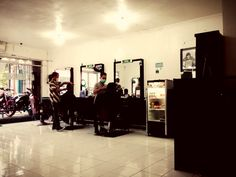 Arfa barbershop. Local budget hairdresser. With 12K you can get your hair restyle, get washed and get some nutrition. Plus a chilled glass of drink. Also freshened towel to make you always feel fresh. It is said for all textures and ages. Recommended