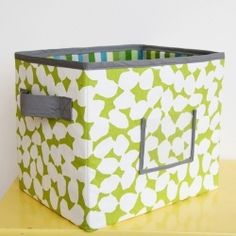 Create your own custom fabric boxes to fit that cubby hole just right. With plastic canvas inserts to keep the sides sturdy.