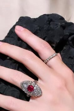 Antique ring centering an 1.67 oval ruby with GIA stating it is untreated from Myanmar. Within a navette plaque of old mine round, cushion, and pear-shaped diamonds of 29 diamonds of 3.20 carats. Mounted in silver and gold. Center: 24.6 x 4.9mm. Shank: 1.4 x 2.2 mm. Circa 1870