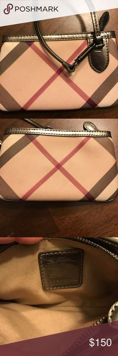 BURBERRY Wristlet Really great condition - used this only a couple of times (I prefer big purses and don't carry wristlets). Tried to get  as clear a pic of the inside as possible. Could only find one minor flaw- a very small stain on the interior which is in the last pic. It's pretty faint, but wanted to show it. Burberry Bags Clutches & Wristlets