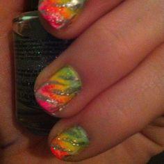 Rainbow nails with silver zebra
