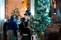First Lady Michelle Obama Takes Military Kids through the White House at Christmas