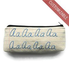 Custom Initial Zipper Pouch by Montclair Made on Scoutmob Shoppe  -  looks like notebook paper.  want.     lj
