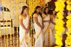 Kerala kasavu sari. Mundu set.White kanchipuram silk sari. Bun with fresh flowers.Malayalee bride. Malayalee groom. Kerala wedding. South Indian bride.South Indian wedding.